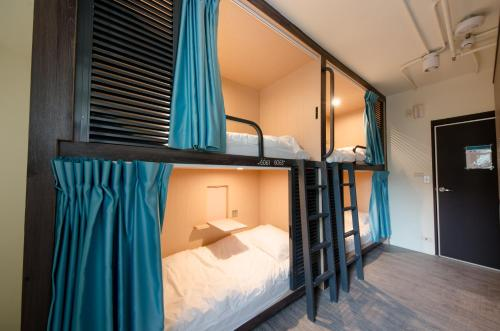 A bunk bed or bunk beds in a room at Loosha Hostel