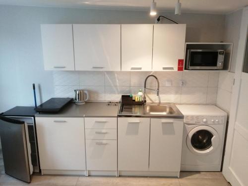 Kuchnia lub aneks kuchenny w obiekcie Apartamenty Przy Rynku