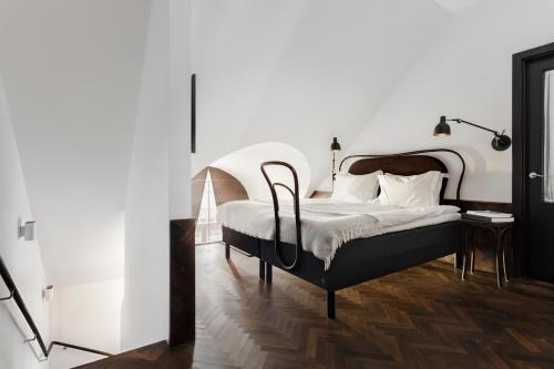 A bed or beds in a room at Miss Clara by Nobis, Stockholm, a Member of Design Hotels™