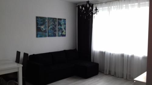 A seating area at Apartament LUX w centrum Konina