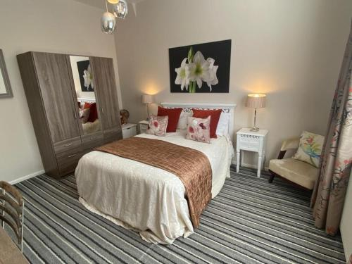 A bed or beds in a room at Blackpool Holiday Lets