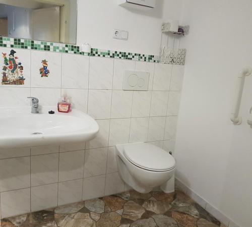 Ein Badezimmer in der Unterkunft Maurushaus