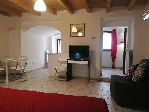 A television and/or entertainment center at La Corte Del Borgo Antico