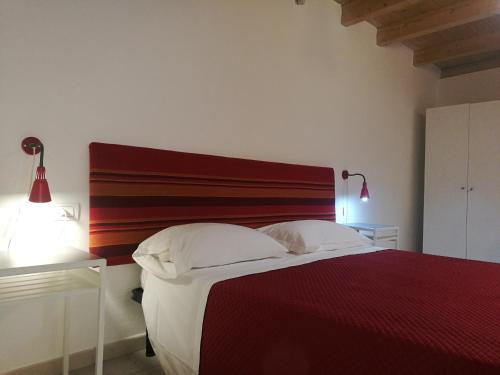 A bed or beds in a room at La Corte Del Borgo Antico