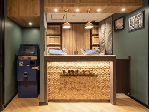 The lobby or reception area at Super Hotel Hida Takayama