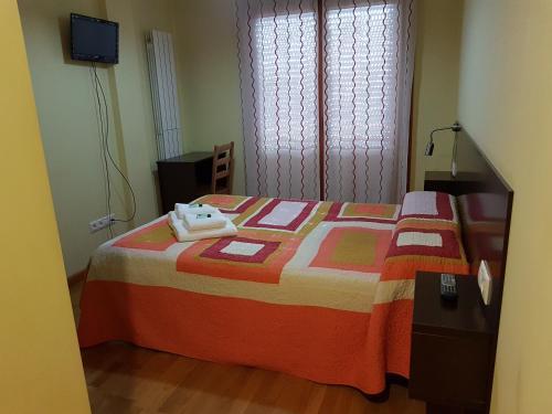 A bed or beds in a room at APARTAMENTOS CASAS NOVAS