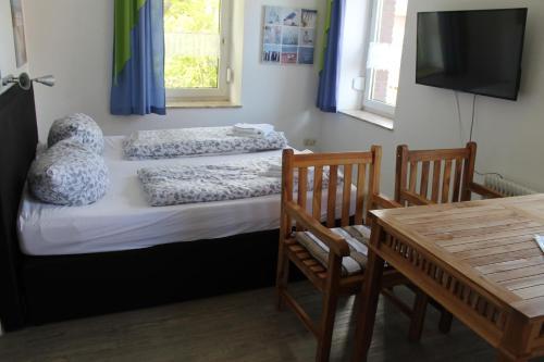 Кровать или кровати в номере Apartmenthaus Seestern