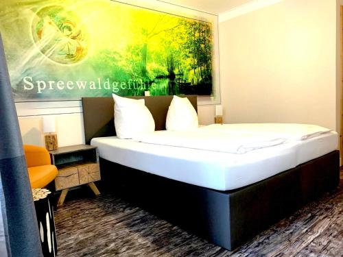 A bed or beds in a room at Spree - Waldhotel Cottbus