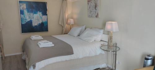 Een bed of bedden in een kamer bij Maizon