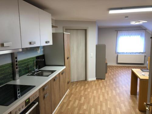 Kuchyň nebo kuchyňský kout v ubytování Ferienwohnung Kleistring
