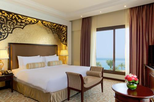 A bed or beds in a room at Marjan Island Resort & Spa Managed By Accor