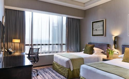 A bed or beds in a room at Carlton City Hotel Singapore (SG Clean)