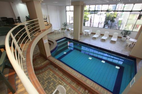 The swimming pool at or close to Hotel Blumenau - Balneário Camboriú