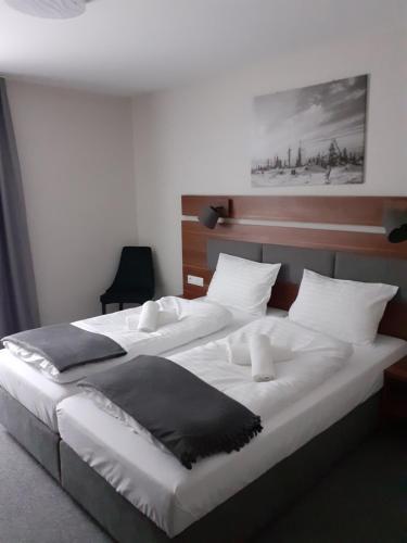 Łóżko lub łóżka w pokoju w obiekcie Gucio