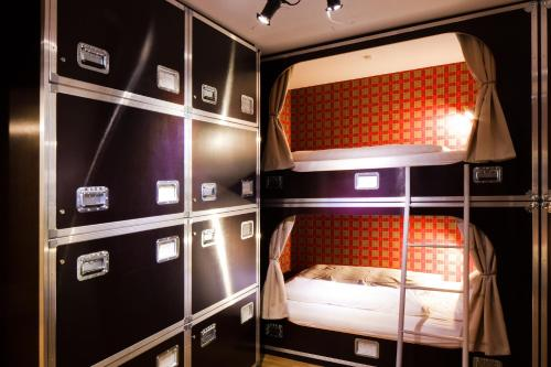 A bunk bed or bunk beds in a room at Hostel die Wohngemeinschaft