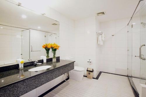 Ein Badezimmer in der Unterkunft River Prince Hotel