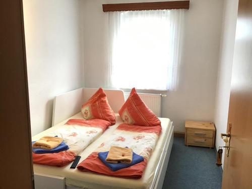 Ein Bett oder Betten in einem Zimmer der Unterkunft Pension&Gasthaus Zschirnsteinbaude