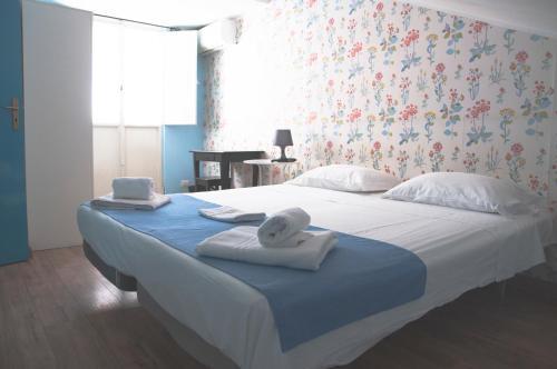 Un ou plusieurs lits dans un hébergement de l'établissement City-In Hostel B&B