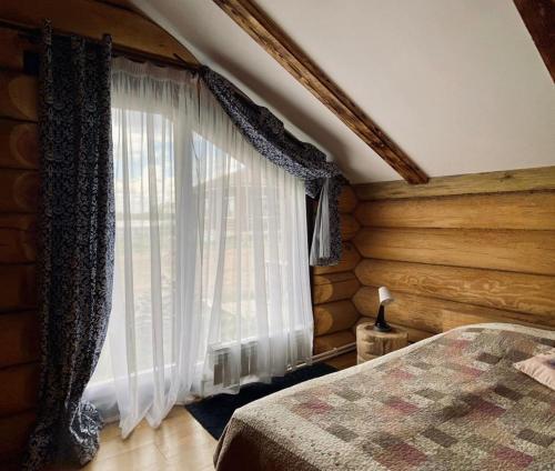 Кровать или кровати в номере Загородный клуб СВИДОМ