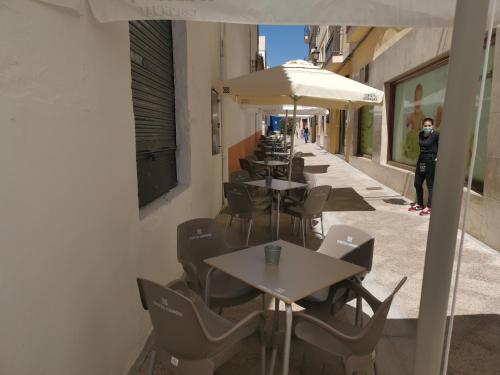 A restaurant or other place to eat at Hotel Mesón El Número Uno