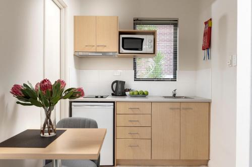 A kitchen or kitchenette at Quest Bunbury