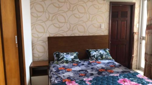 A bed or beds in a room at Happy House