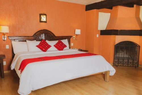 Łóżko lub łóżka w pokoju w obiekcie Plaza Magnolias