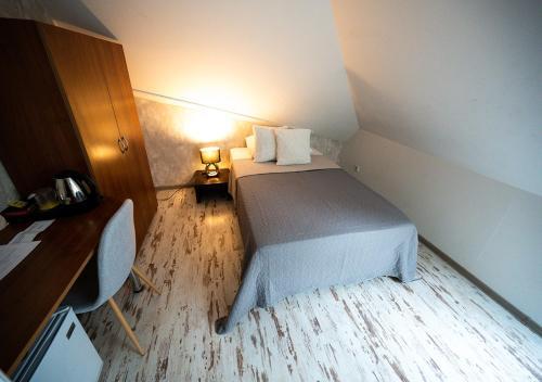 Posteľ alebo postele v izbe v ubytovaní Penzion Pri Parku