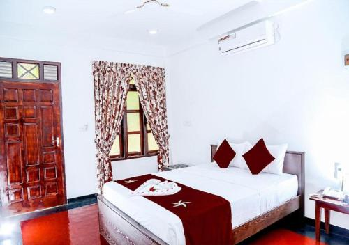 A bed or beds in a room at Crescent Sea Resort