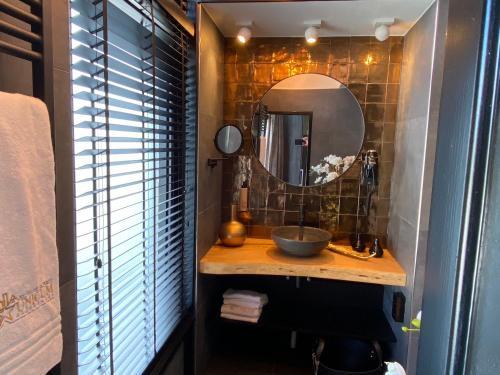 Een badkamer bij Hotel-Restaurant Unicum Elzenhagen
