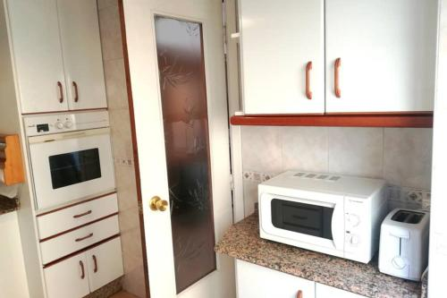 Una cocina o zona de cocina en bonito apartamento centro onil