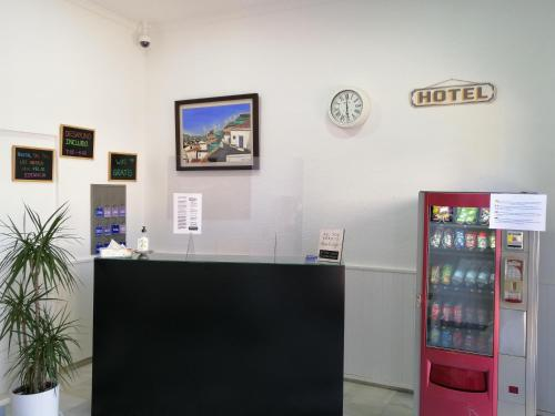 The lobby or reception area at Hostal Del Sol
