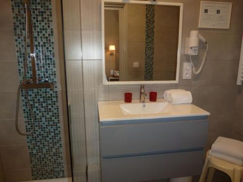 Salle de bains dans l'établissement Hotel Espadon