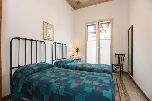 A bed or beds in a room at B&B Via Roma