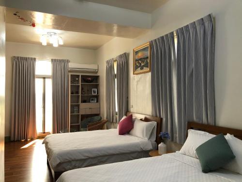 傅院子民宿 房間的床