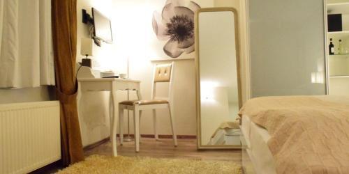 Ein Bett oder Betten in einem Zimmer der Unterkunft La Petite Perle
