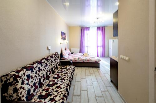 A bed or beds in a room at Kozette Apartaments
