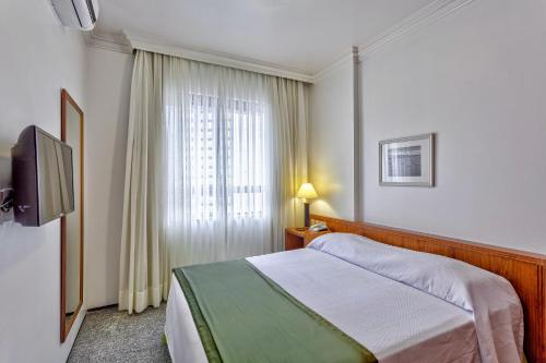 A bed or beds in a room at Tulip Inn Fortaleza