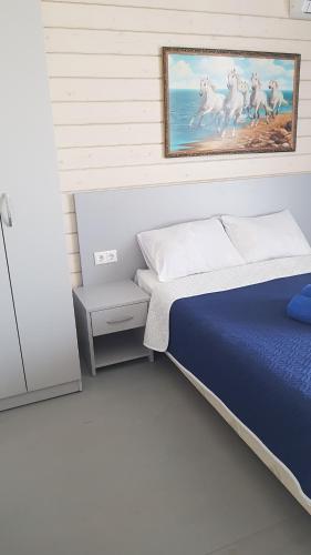 Кровать или кровати в номере Каравелла
