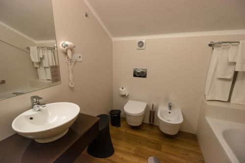 Uma casa de banho em Hotel das Salinas