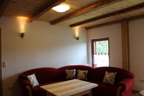 Ein Sitzbereich in der Unterkunft Gästehaus zum Prinzenfelsen