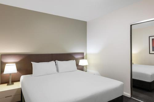 A bed or beds in a room at Adina Apartment Hotel Sydney Central