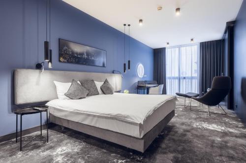 Łóżko lub łóżka w pokoju w obiekcie Mamaison Residence Diana