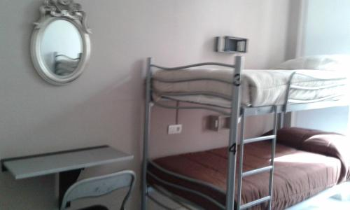 A bunk bed or bunk beds in a room at Granada Old Town Hostel