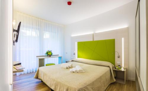 A bed or beds in a room at Design Nature Apartment