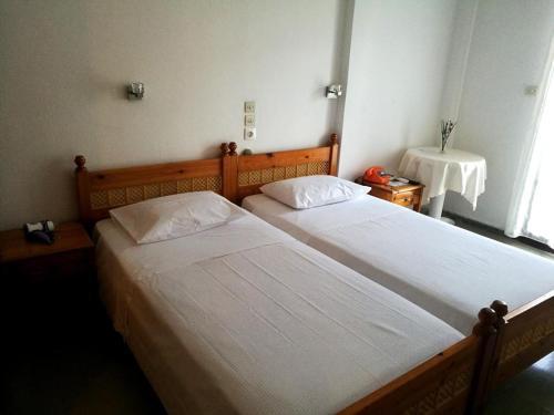 Ένα ή περισσότερα κρεβάτια σε δωμάτιο στο Hotel Rena