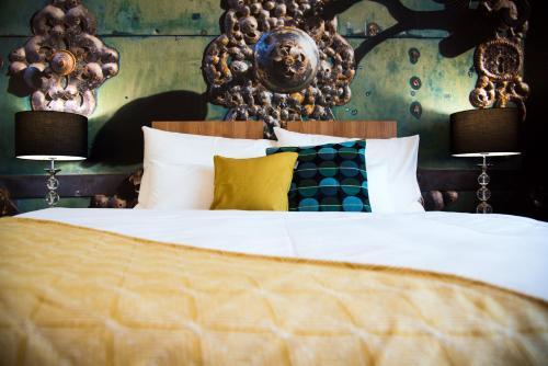 Postel nebo postele na pokoji v ubytování Hotel Golf Garni