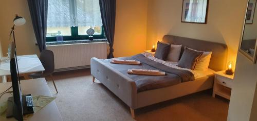 Ein Bett oder Betten in einem Zimmer der Unterkunft Gasthof Pritzier