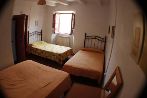 A bed or beds in a room at La Mochila