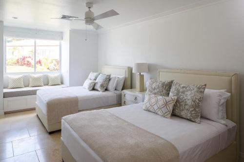 A bed or beds in a room at Windjammer Landing Villa Beach Resort